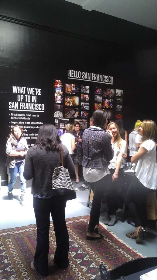 Bloggers, along with news and magazine reporters, at Converse's media luncheon at the pop-up event space, complete with DJ booth and skylights.