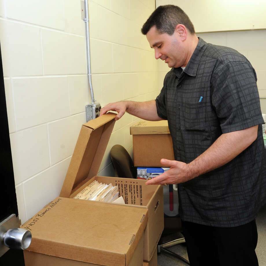 Bridgeport Police Detective John Burke shows the boxes containing files pertaining to the missing persons investigation for Bianca Lebron, in Bridgeport, Conn., May 8th, 2013. Lebron was 10 when she was last seen outside Elias Howe School, in Bridgeport, on Nov. 7th, 2001. Detective Burke is currently in charge of the Lebron investigation. Photo: Ned Gerard / Connecticut Post