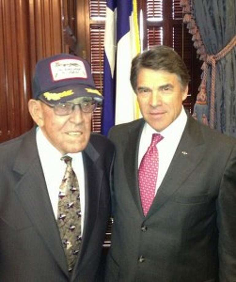 then-Gov. Rick Perry with his father, WWII veteran Ray Perry, at the Texas Capitol on Wednesday to commemorate VE Day. Photo courtesy of Gov. Perry's Twitter feed.