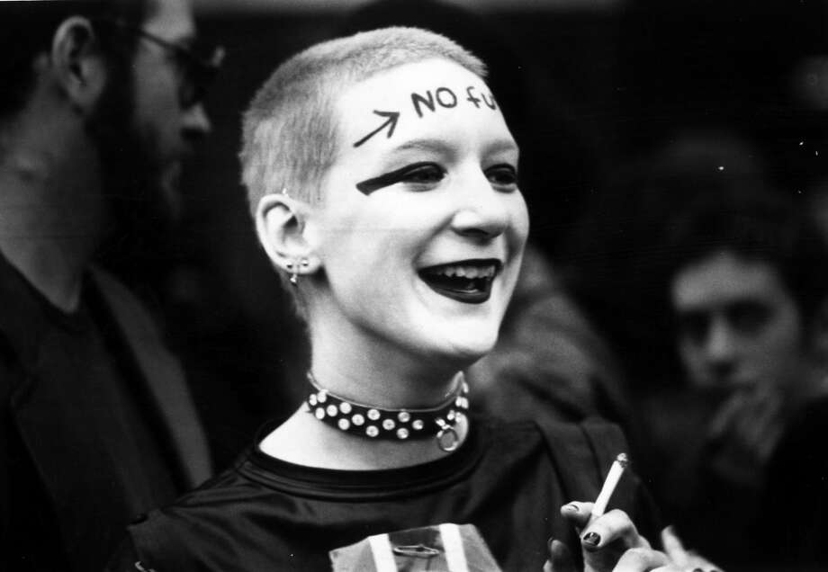 A girl wearing punk clothes and make up, including the words 'No Future' across her forehead, waiting outside the Rainbow Theatre, London, before a Jam and Clash gig.    (Photo by Chris Moorhouse/Getty Images)