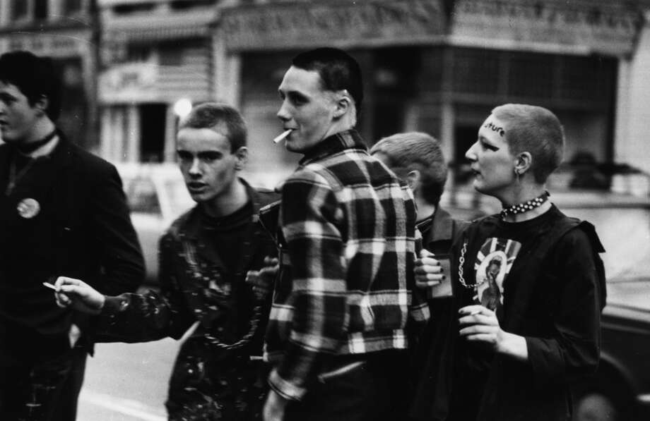 Young punks queuing outside the Rainbow, London, in 1977 to see The Clash and The Jam in concert.  (Photo by Chris Moorhouse/Evening Standard/Getty Images)