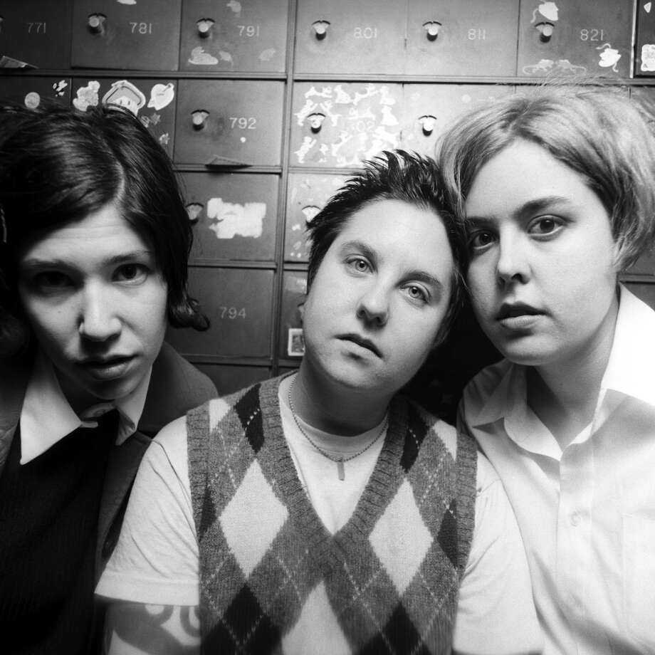 American riot girl band Sleater-Kinney (L - R) lead guitarist/vocalist Carrie Brownstein, drummer Lora McFareland and lead vocalist/guitarist Corin Tucker pose for a March 1996 portrait  in Byrn Mawr, Pennsylvania. ( Photo by Bob Berg/Getty Images)