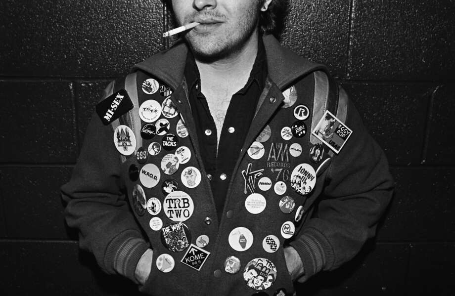 A punk music fan sporting his favorite bands in an array of buttons on his coat poses during a 1979 Los Angeles, California, portrait session in the hallway of the downtown Elk's Lodge. (Photo by George Rose/Getty Images)