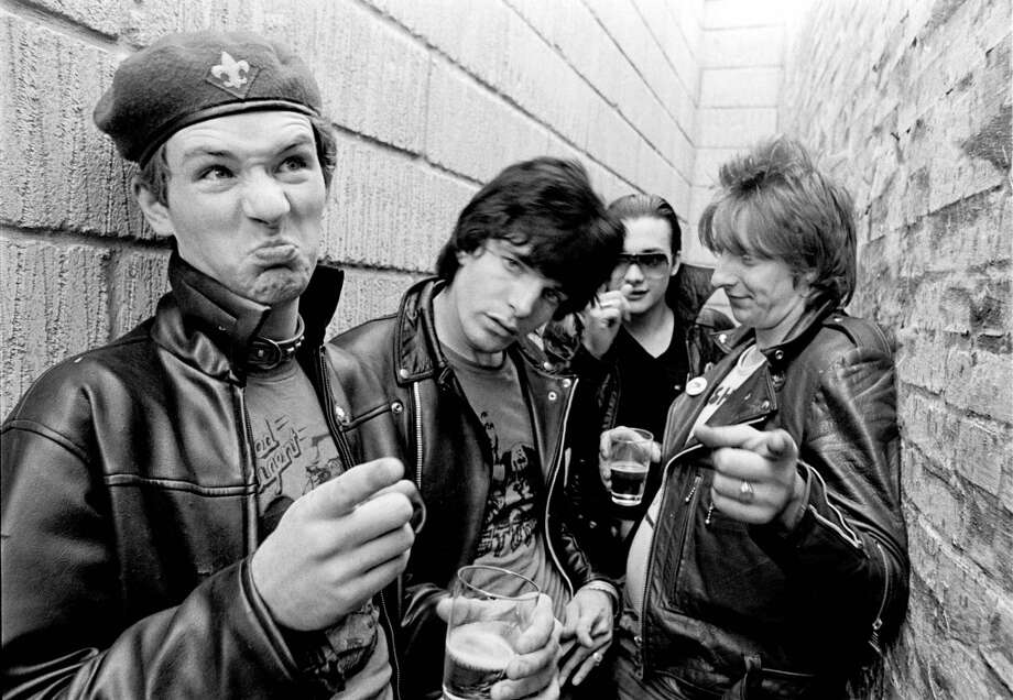 Captain Sensible, Brian James, Dave Vanian and Rat Scabies of punk band The Damned pose for a group shot in an alleyway in spring 1977 in Denmark. (Photo by Jorgen Angel/Redferns)
