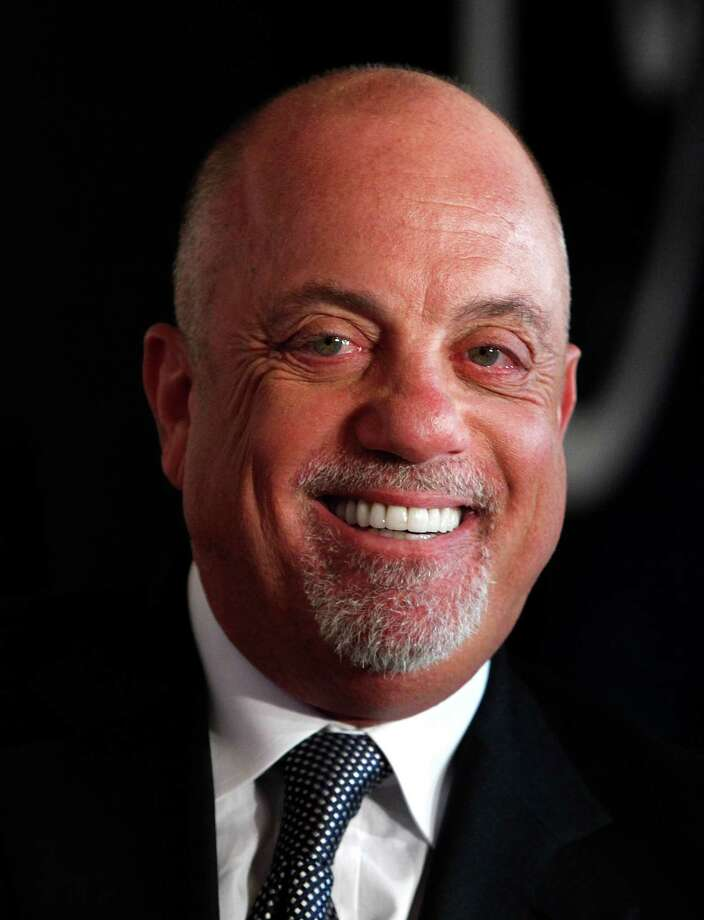 FILE - In this June 17, 2010 file photo, Billy Joel attends the 2010 Songwriters Hall of Fame awards gala in New York. Joel is recovering from double hip-replacement surgery. Joel spokeswoman Claire Mercuri told People magazine Wednesday, Nov. 24, 2010, that the 61-year-old pop star had both hips replaced last week to correct a congenital condition. (AP Photo/Peter Kramer, File) Photo: Peter Kramer / KRAPE