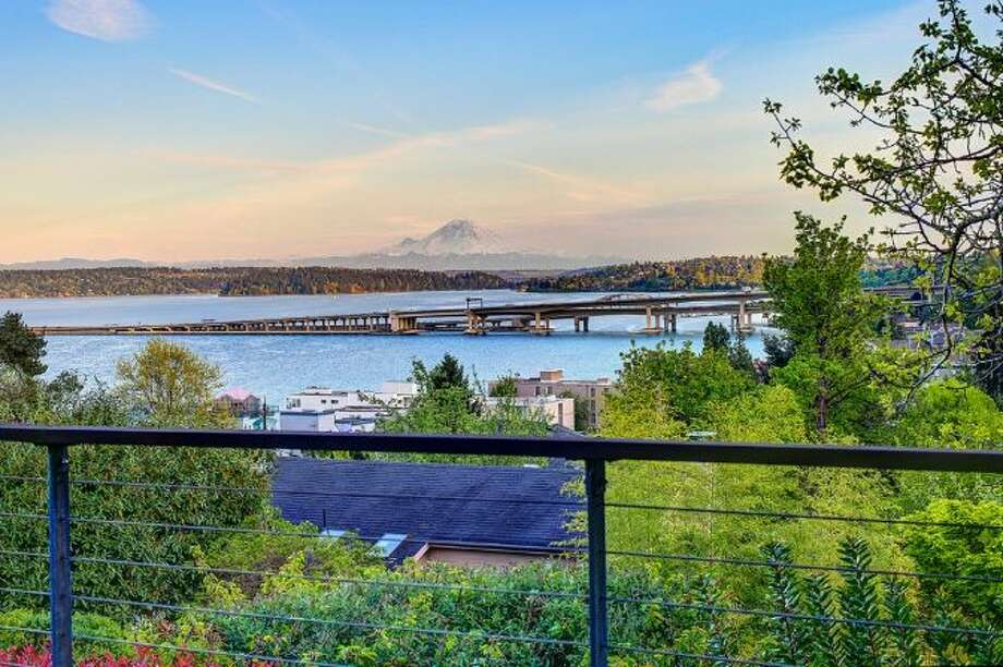 View from 414 34th Ave. S., in Leschi. The 3,190-square-foot house, built in 1998, has three bedrooms, 2.25 bathrooms, a two-story living room with walls of windows, steel staircases and landing, decks and a patio on a 7,200-square-foot lot. It's listed for $1.8 million. Photo: HD Estates, Courtesy Kevin O'Doherty, Windermere Real Estate