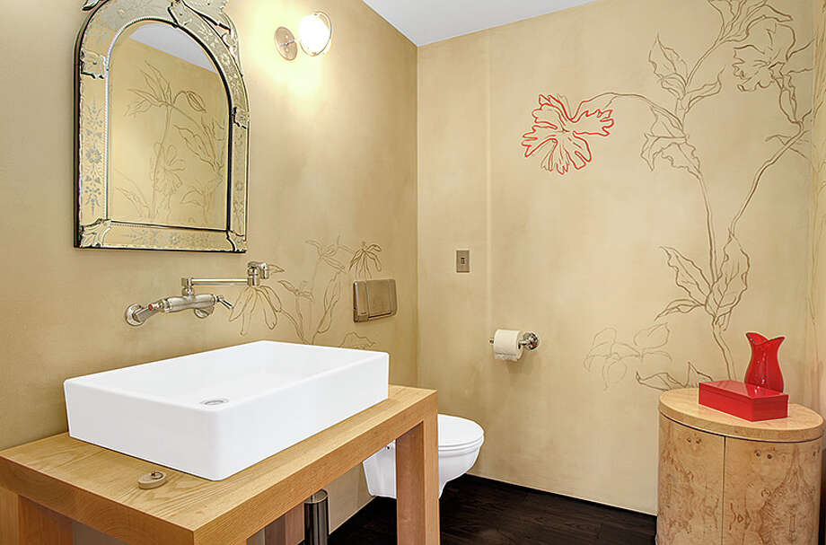 Powder room of 414 34th Ave. S., in Leschi. The 3,190-square-foot house, built in 1998, has three bedrooms, 2.25 bathrooms, a two-story living room with walls of windows, steel staircases and landing, decks, a patio, and views of Mount Rainier and Lake Washington on a 7,200-square-foot lot. It's listed for $1.8 million. Photo: HD Estates, Courtesy Kevin O'Doherty, Windermere Real Estate