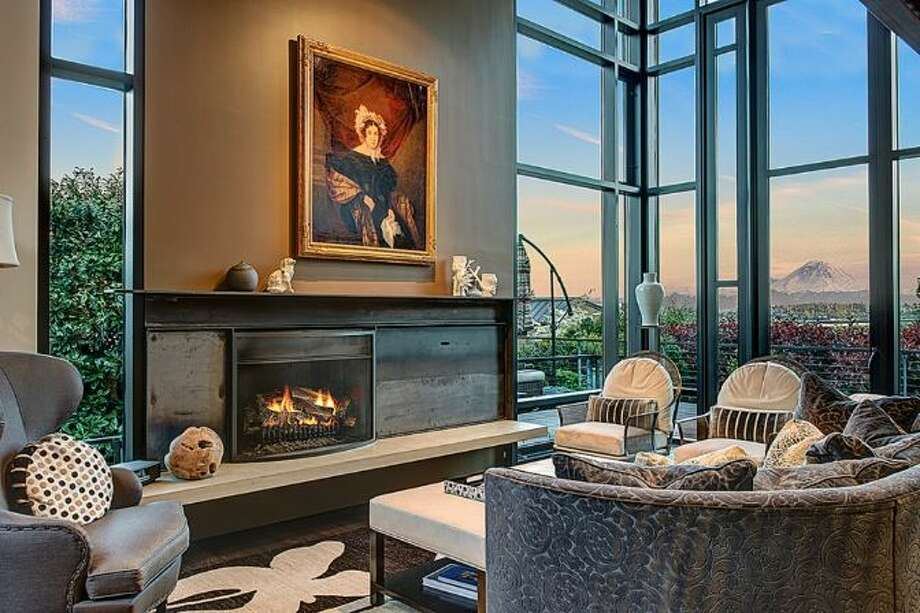 Living room of 414 34th Ave. S., in Leschi. The 3,190-square-foot house, built in 1998, has three bedrooms, 2.25 bathrooms, steel staircases and landing, decks, a patio, and views of Mount Rainier and Lake Washington on a 7,200-square-foot lot. It's listed for $1.8 million. Photo: HD Estates,  Courtesy Kevin O'Doherty,  Windermere Real Estate