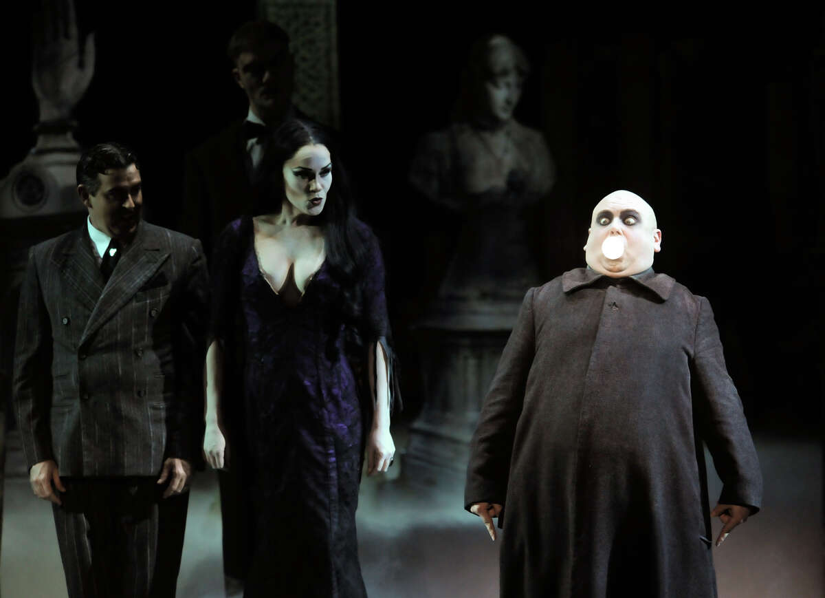 Shaun Rice (right) is Uncle Fester during Tuesday's opening performance of The Addams Family at the Majestic Theater. Jesse Sharp portrays Gomez Addams with Keleen Snowgren in the part of Morticia Addams and San Olson as Lurch.