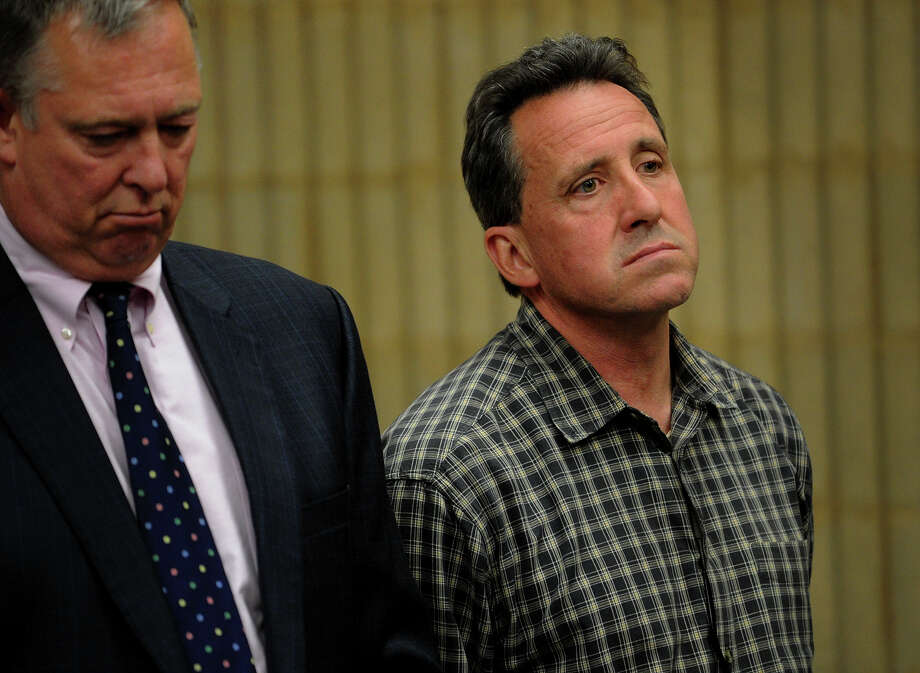 Neil Heslin, right, father of a slain Sandy Hook first grader, appears with lawyer Bruce Weiant to face a variety of motor vehicle and criminal charges at Superior Court in Milford, Conn. on Wednesday, May 8, 2013. Photo: Brian A. Pounds / Connecticut Post