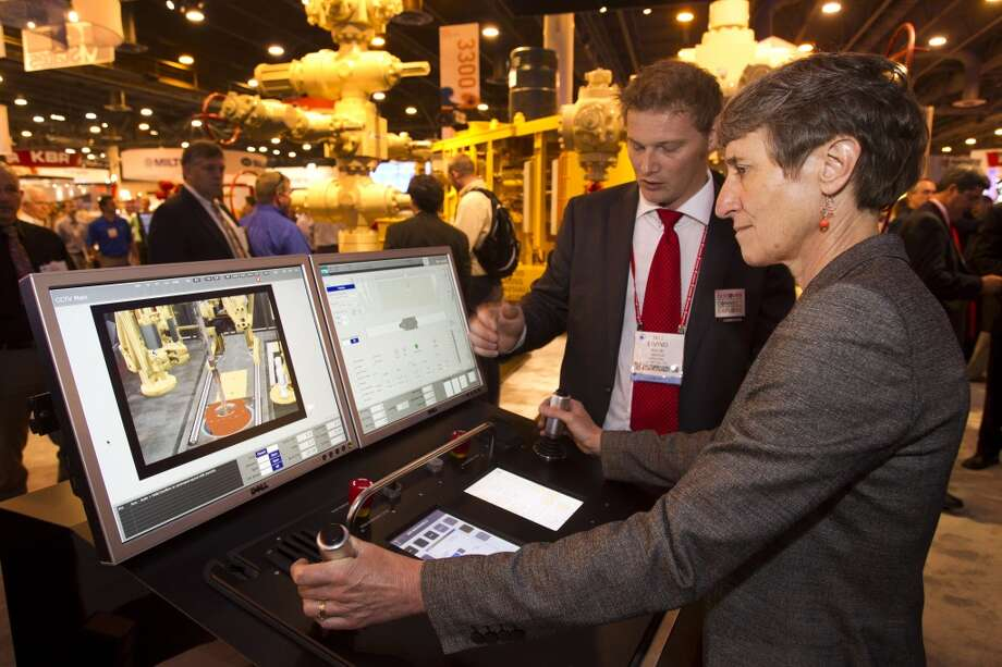 Eivind Sundel, left, helps Secretary of the Interior Sally Jewell, run a drilling simulator as she toured the exhibition floor during OTC2013 at Reliant Park Wednesday, May 8, 2013, in Houston. ( Brett Coomer / Houston Chronicle ) Photo: Brett Coomer, Houston Chronicle