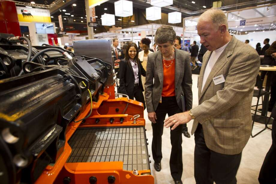 Secretary of the Interior Sally Jewell, left, talks to Dan Jefferson about a double deck shaker at the Mi SWACO booth  run a drilling simulator as she toured the exhibition floor during OTC2013 at Reliant Park Wednesday, May 8, 2013, in Houston. ( Brett Coomer / Houston Chronicle ) Photo: Brett Coomer, Houston Chronicle