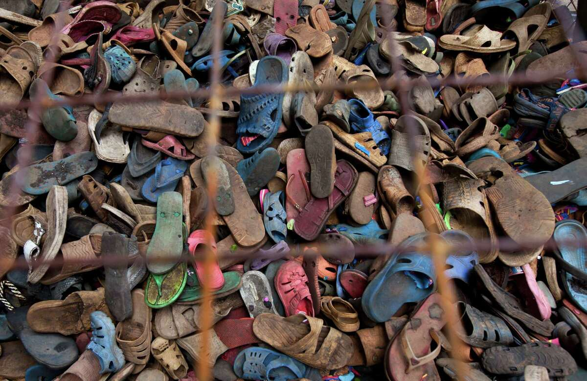 In this photo taken Monday, April 29, 2013, a pile of discarded flip-flops sits in a crate ready to be washed, sorted, and carved into toy animals, at the Ocean Sole flip-flop recycling company in Nairobi, Kenya. The company is cleaning the East African country's beaches of used, washed-up flip-flops and the dirty pieces of rubber that were once cruising the Indian Ocean's currents are now being turned into colorful handmade giraffes, elephants and other toy animals.