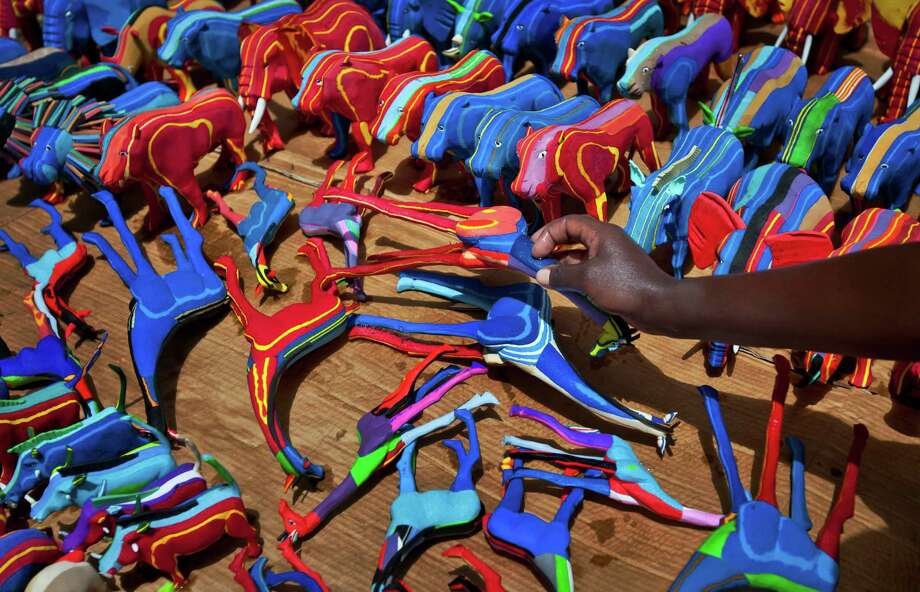 In this photo taken Monday, April 29, 2013, finished toy animals made from pieces of discarded flip-flops are laid out in rows to dry in the sun, having just been washed, at the Ocean Sole flip-flop recycling company in Nairobi, Kenya. The company is cleaning the East African country's beaches of used, washed-up flip-flops and the dirty pieces of rubber that were once cruising the Indian Ocean's currents are now being turned into colorful handmade giraffes, elephants and other toy animals. Photo: Ben Curtis, AP / AP