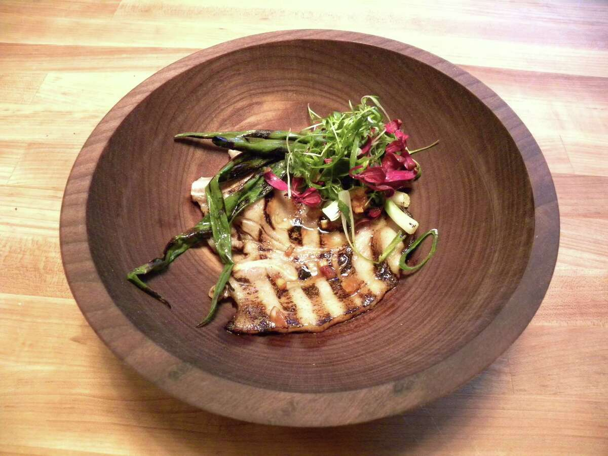 STEVE BARNES/TIMES UNION Flash-grilled pork with grilled scallion, baby lettuce and tangerine mostarda.