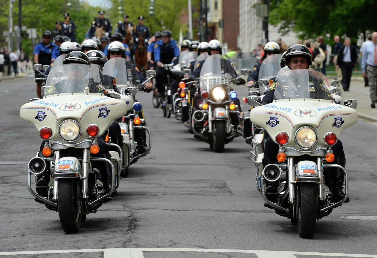 A police motorcycle honor guard lead by the Albany Police enters the Empire Plaza Wednesday May 8, 2013, for the State of New York Police Officers' Memorial Remembrance Ceremony in Albany, N.Y. (Skip Dickstein/Times Union)