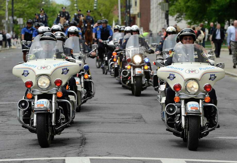 A police motorcycle honor guard lead by the Albany Police enters the Empire Plaza Wednesday May 8, 2013, for the State of New York Police Officers' Memorial Remembrance Ceremony in Albany, N.Y.   (Skip Dickstein/Times Union) Photo: SKIP DICKSTEIN / 00022315A