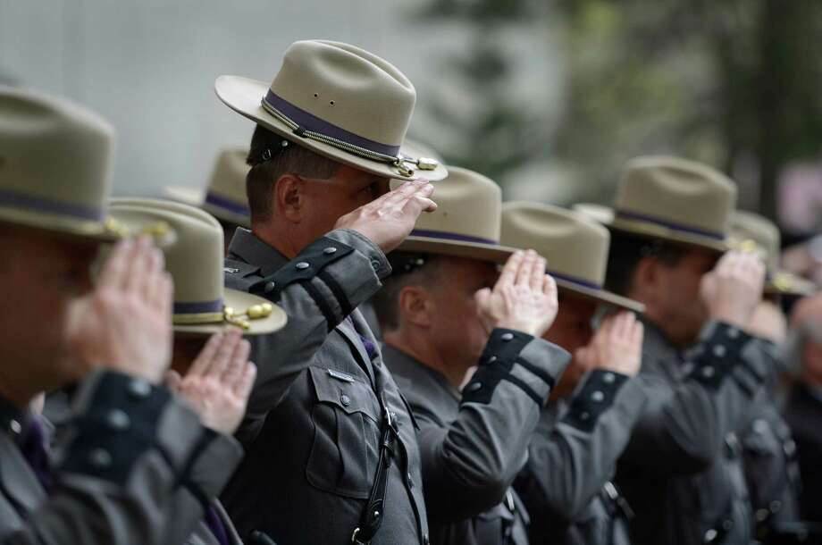 Members of the New York State Police salute during the playing of taps Wednesday May 8, 2013, during the State of New York Police Officers' Memorial Remembrance Ceremony in Albany, N.Y.   (Skip Dickstein/Times Union) Photo: SKIP DICKSTEIN / 00022315A