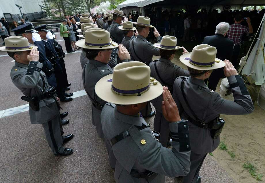 Members of the New York State Police contingent salute on Wednesday, May 8, 2013, during the State of New York Police Officers' Memorial Remembrance Ceremony in Albany, N.Y.   (Skip Dickstein/Times Union) Photo: SKIP DICKSTEIN / 00022315A