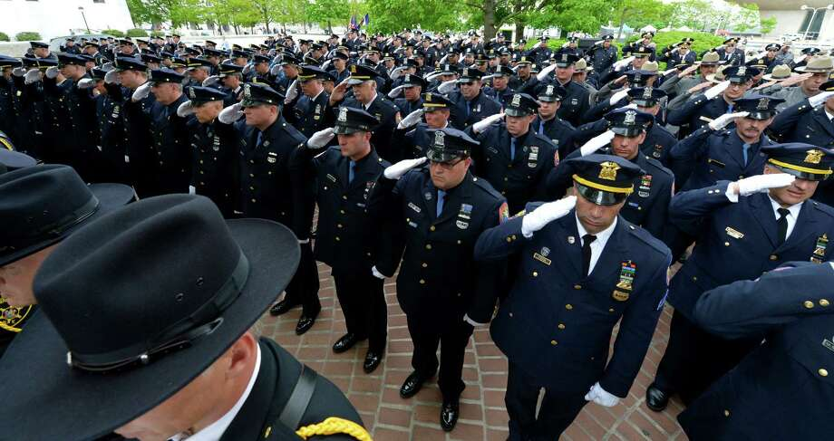 Members of the Nassau County Police salute on Wednesday, May 8, 2013, during the State of New York Police Officers' Memorial Remembrance Ceremony in Albany, N.Y.   (Skip Dickstein/Times Union) Photo: SKIP DICKSTEIN / 00022315A
