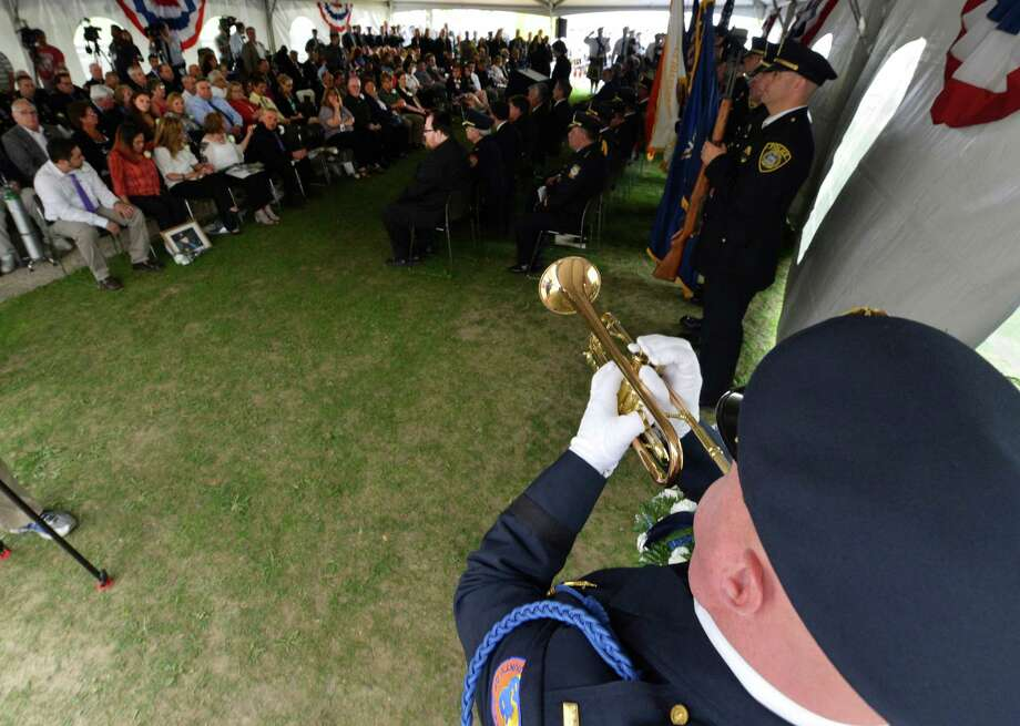 Lt. Gus Kalin of the Nassau County Police and  honor guard plays taps Wednesday, May 8, 2013, during the State of New York Police Officers' Memorial Remembrance Ceremony in Albany, N.Y.   (Skip Dickstein/Times Union) Photo: SKIP DICKSTEIN / 00022315A