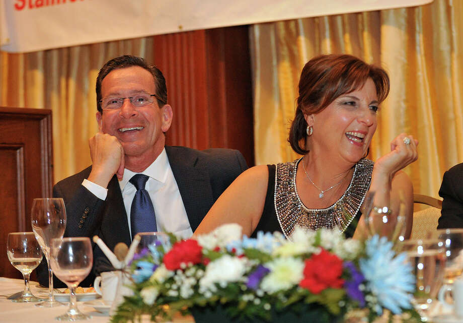 Jami Sherwood, right, this year's recipient of Stamford's 68th annual Citizen of the Year Award, watches a short video about her life as Gov. Dannel P. Malloy looks on during the award reception in Sherwood's honor at the Italian Center of Stamford on Tuesday, May 7, 2013. Photo: Jason Rearick / Stamford Advocate