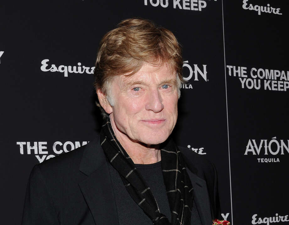 "FILE - This April 1, 2013 file photo shows director and actor Robert Redford at the premiere of ""The Company You Keep"" at The Museum of Modern Art in New York. CNN is planning an unscripted series about Chicago that will be executive-produced by Robert Redford. The eight-part series, ""Chicagoland,"" will premiere in 2014.  (Photo by Evan Agostini/Invision/AP, file) Photo: Evan Agostini"