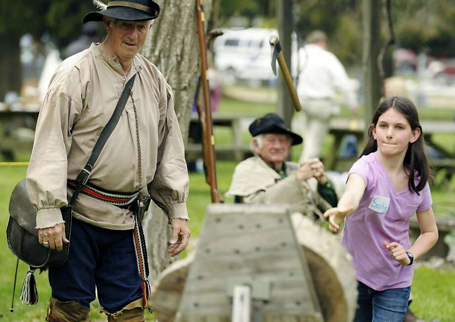 Nice delivery, rook:Ten-year-old Sophie Taylor hurls a tomahawk at a target as Connecticut Yankees Rich Trudel and