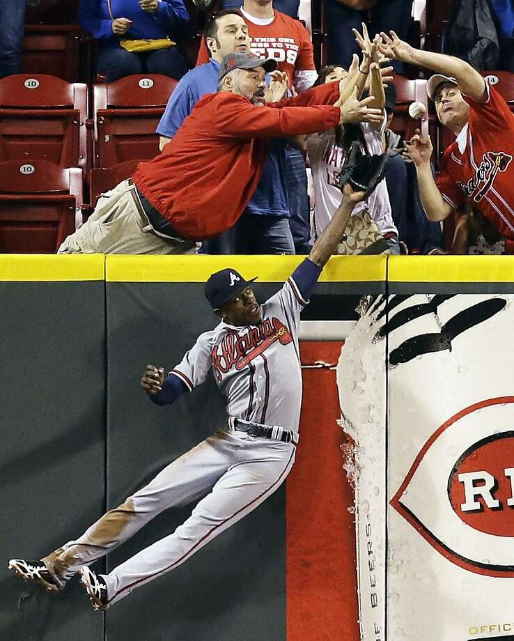 A thriller in Cincy: B.J. Upton leaps, but cannot catch a home run by the Reds' Devin Mesoraco, who was down to his final strike with two 