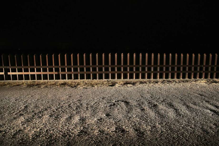 A section of the U.S.-Mexico border fence stands  in La Joya. Conservatives want to control the wrong things about immigration. Photo: John Moore, Getty Images