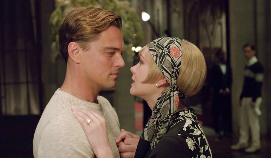 "Leonardo DiCaprio plays Jay Gatsby to Carey Mulligan's Daisy Buchanan in ""The Great Gatsby,"" in Baz Luhrmann's adaptation of F. Scott Fitzgerald's novel. Photo: Warner Bros."