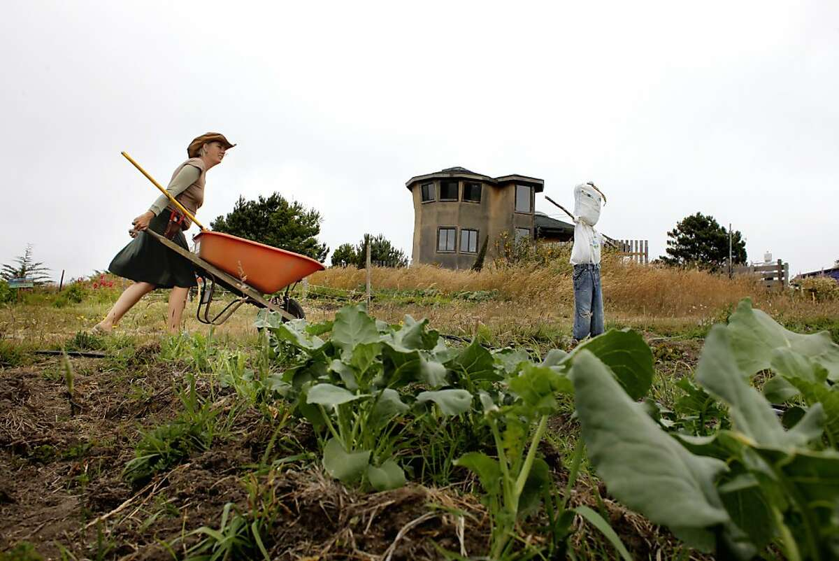 Jennifer Ketring hauls compost through the garden, Monday June 11, 2011, in Point Arena, Calif.