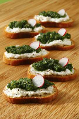 Radish leaf pesto crostini as seen in San Francisco, California, on May 1, 2013. Food styled by Lynne Bennett.