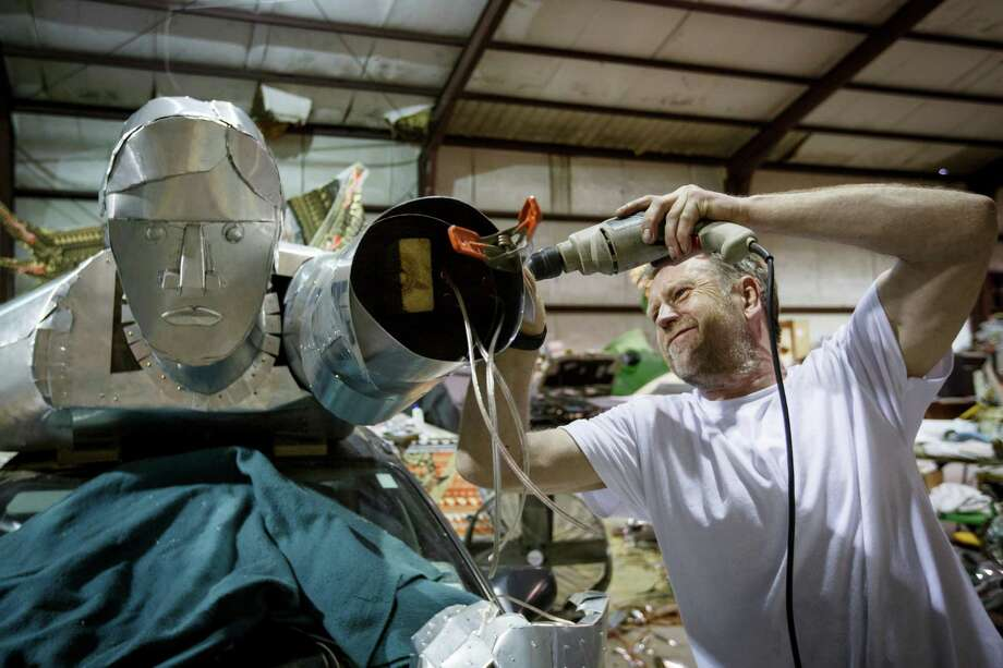 "Welsh artist Andy Hazell works on the aluminum sheeting of his art car named ""Heroicar"" commissioned by the Orange Show for this year's Art Car Parade, Thursday, May 2, 2013, in Houston. Photo: Michael Paulsen, Houston Chronicle / © 2013 Houston Chronicle"