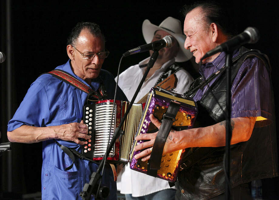 Santiago Jimenez Jr. (left) and his brother Flaco Jimenez reunited during the Tejano Conjunto Festival in 2012. Flaco will return to the event this year. Photo: Express-News File Photo