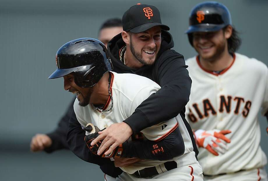 SAN FRANCISCO, CA - MAY 08:   Andres Torres #56 of the San Francisco Giants is hugged by George Kontos #70 after Torres hit an RBI walk-off single scoring Buster Posey #28 (not pictured) to defeat the Philadelphia Phillies 4-3 in the bottom of the 10th inning at AT&T Park on May 8, 2013 in San Francisco, California.  (Photo by Thearon W. Henderson/Getty Images) Photo: Thearon W. Henderson, Getty Images