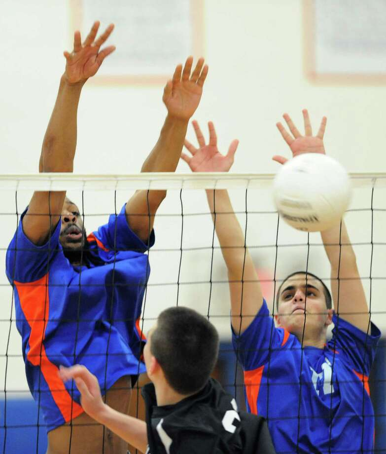 Danbury's Corey Spruill, left, and William Tanner go up for a block during during Danbury's 3-1 (23-25, 25-19, 25-22, 25-19) win over Trumbull at Danbury High School in Danbury, Conn. on Wednesday, May 8, 2013. Photo: Tyler Sizemore / The News-Times