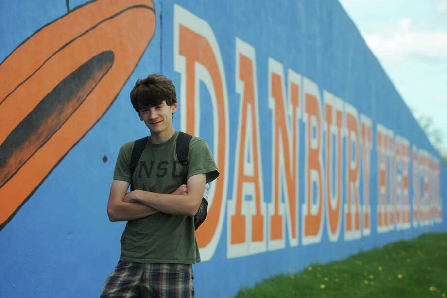 Corey Mullins, a sophomore at Danbury High School, poses outside the school on Tuesday, May 7, 2013.  Mullins is attempting to raise money for the track program at Bassick High School in Bridgeport, Conn., which currently lacks the necessary funding to support the program. Photo: Tyler Sizemore / The News-Times