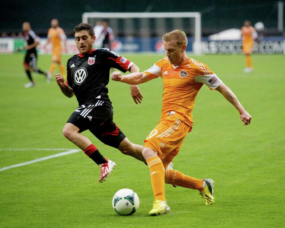 Houston Dynamo midfielder Andrew Driver (20) sends a crossing pass  past D.C. United defender Chris Korb (22) in the first half at RFK Stadium in Washington, D.C., Wednesday, May 8, 2013. (Chuck Myers/MCT) Photo: Chuck Myers, McClatchy-Tribune News Service / MCT