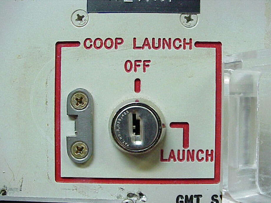 "FILE - This 2002 file photo provided by the National Park Service shows the launch key mechanism at the deactivated Delta Nine Launch Facility near Wall, S.D. The Air Force stripped an unprecedented 17 officers of their authority to control _ and if necessary launch _ nuclear missiles after a string of unpublicized and unacceptable failings, including a potential compromise of missile launch codes. The group's deputy commander said it is suffering ""rot"" within its ranks. The tip-off to trouble was a March 2013 inspection of the 91st Missile Wing at Minot Air Force Base, N.D., which earned the equivalent of a ""D"" grade when tested on its mastery of Minuteman III missile launch operations. (AP Photo/Minuteman Missile NHS) Photo: Anonymous"
