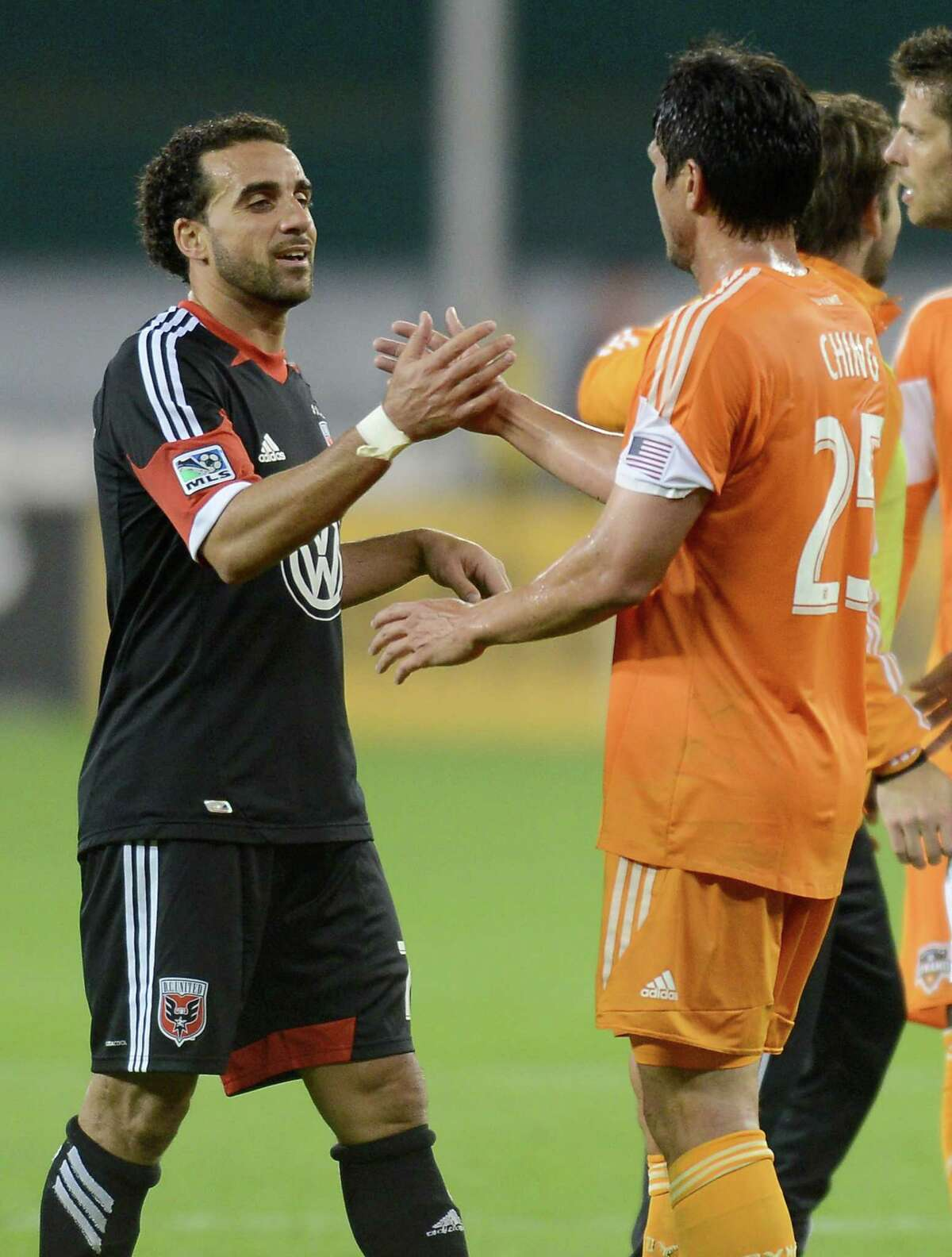 D.C. United midfielder Dwayne De Rosario (7) greets his former Houston Dynamo teammate Brian Ching (25) following the match at RFK Stadium in Washington, D.C., Wednesday, May 8, 2013. Dynamo blanked United, 4-0. (Chuck Myers/MCT)