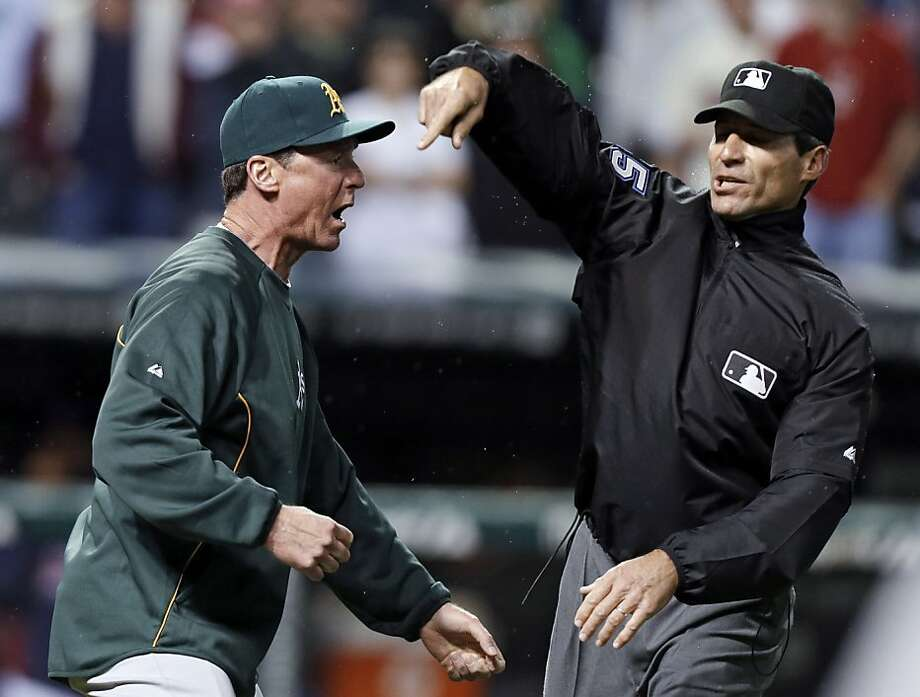 A's manager Bob Melvin gets the heave-ho from umpire Angel Hernandez after he objected to the blown non-home-run call. Photo: Mark Duncan, Associated Press