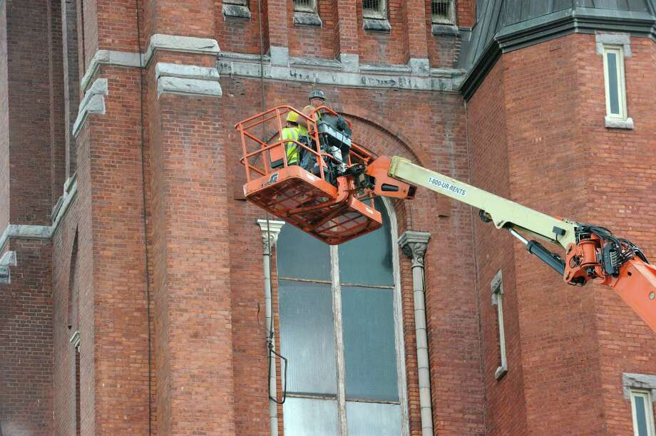 Cable is placed to bring down the last piece of the bell tower at St Patrick's Church by demolition crew on Wednesday, May 8, 2013 in Watervliet, N.Y. (Lori Van Buren / Times Union) Photo: Lori Van Buren / 10022287A