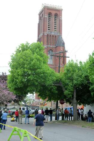 Spectators watch as cable is placed for the last piece of the bell tower at St Patrick's Church to be taken down by demolition crew on Wednesday, May 8, 2013 in Watervliet, N.Y. (Lori Van Buren / Times Union) Photo: Lori Van Buren / 10022287A