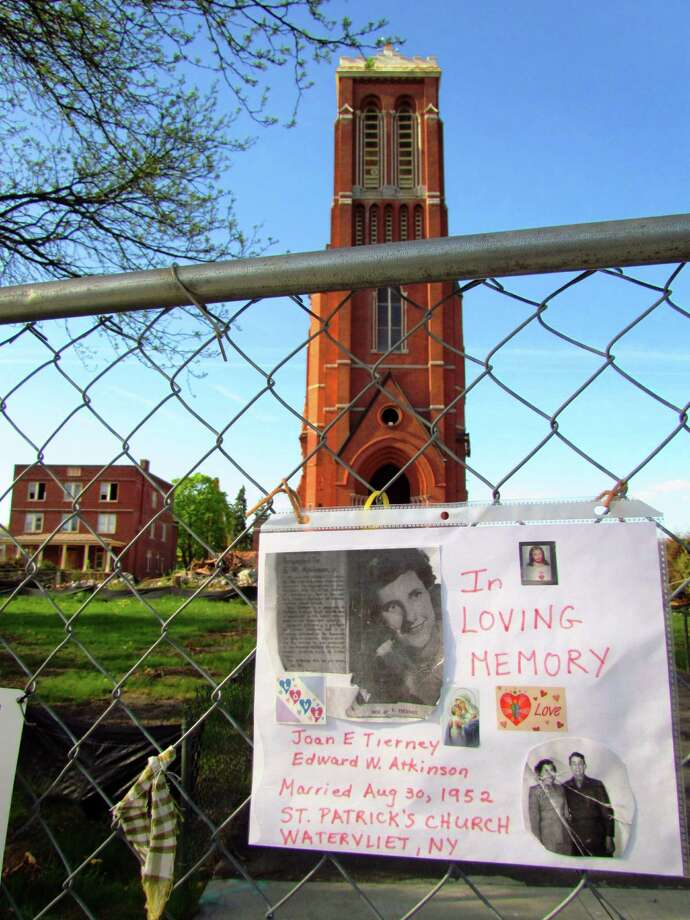 A sign on a fence on Wednesday, May 8, 2013, recalls former parishioners who were married at St. Patrick's Church in Watervliet. (Courtesy Ron Schubin)