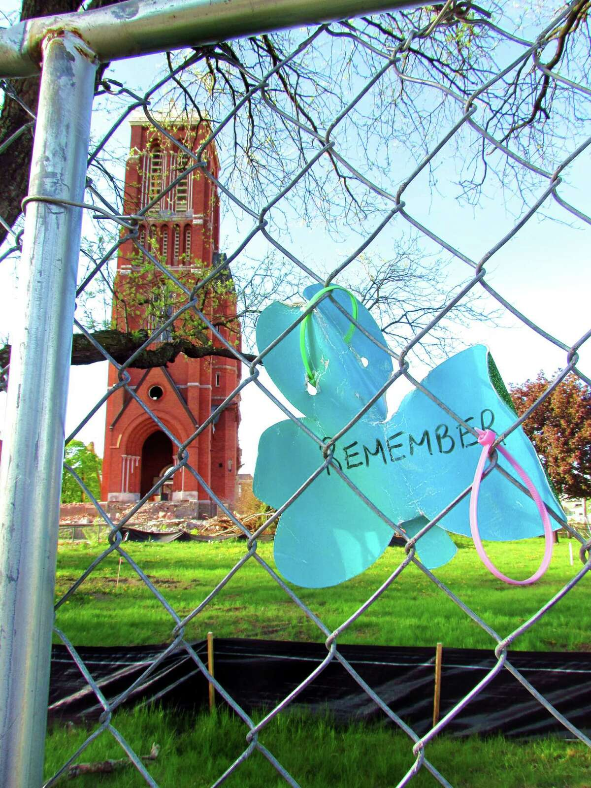A sign hangs on a fence in front of the remains of the bell tower on St. Patrick's Church in Watervliet on Wednesday, May 8, 2013. (Photo courtesy of Ron Schubin)