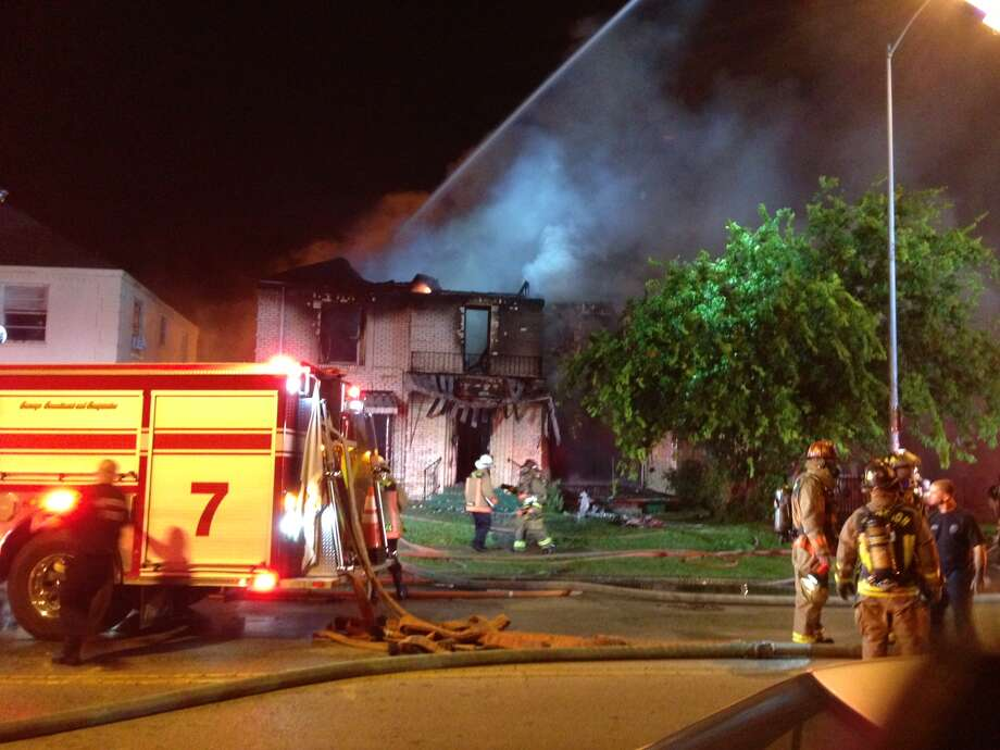 Flames roared through a home in the 2300 block of Wheeler on Wednesday. (Mike Glenn/Chronicle)