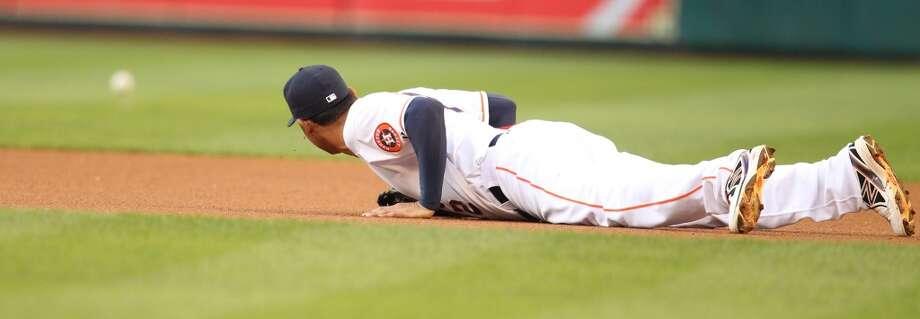 Astros first baseman Carlos Pena (12) watches a Erick Aybar singel get past him. Photo: Karen Warren, Houston Chronicle