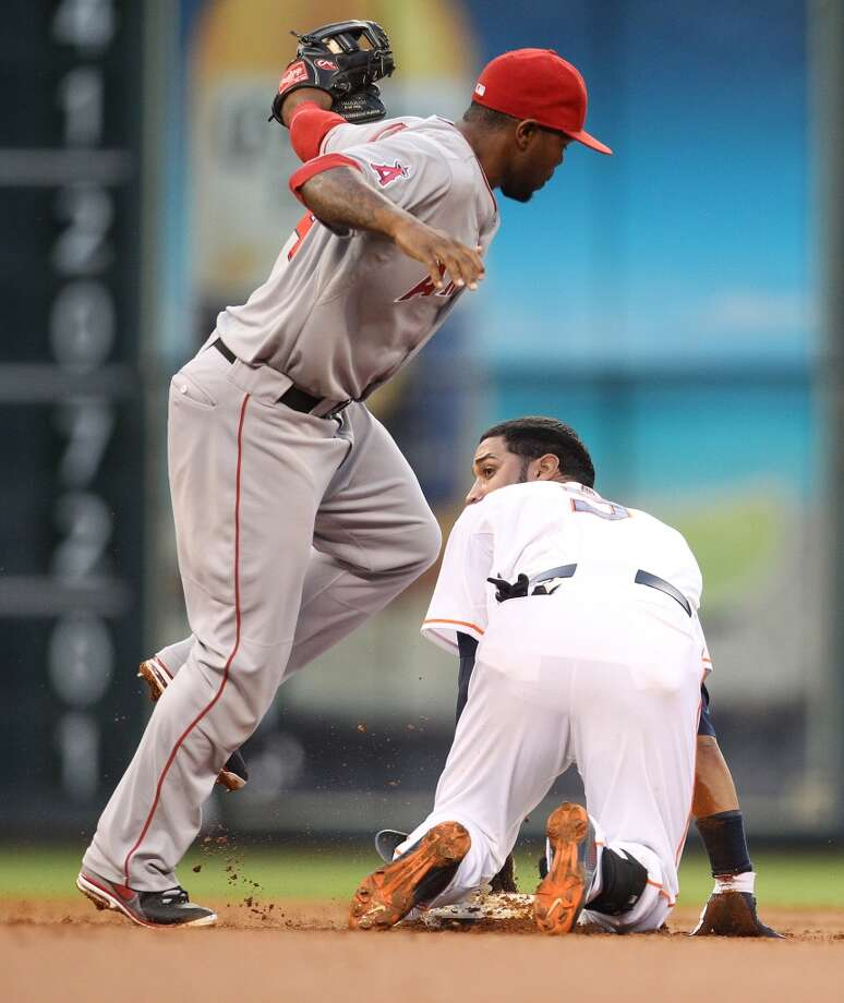 Astros shortstop Marwin Gonzalez (9) slides into second safely after his double. Photo: Karen Warren, Houston Chronicle