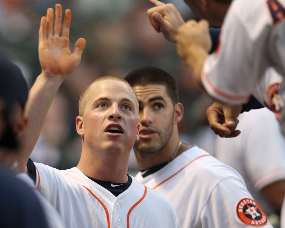 Astros third baseman Matt Dominguez (30) celebrates his run after a RBI double by Marwin Gonzalez (9).